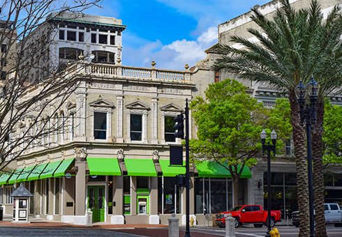 Historic downtown business storefronts on a city block in Jacksonville, Florida.