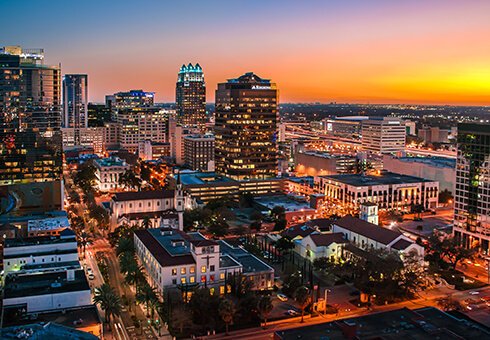 This is a beautiful photo capturing the Downtown Orlando Skyline at sunset.