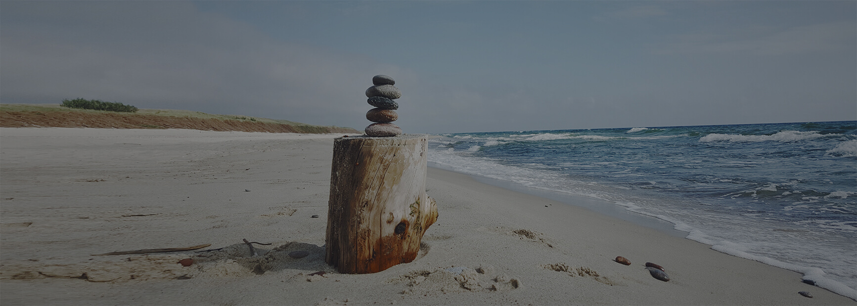 Photo of cairn on beach
