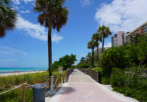 Miami Beach Board Walk with Palm Trees, Blue Sky and Clouds