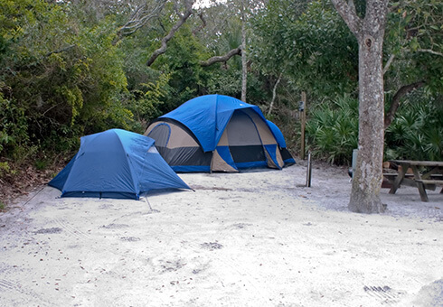 big tent for the adults and small tent for the children at campground
