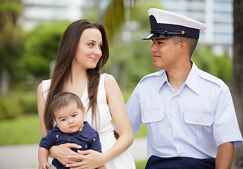 a military man with his family in the park