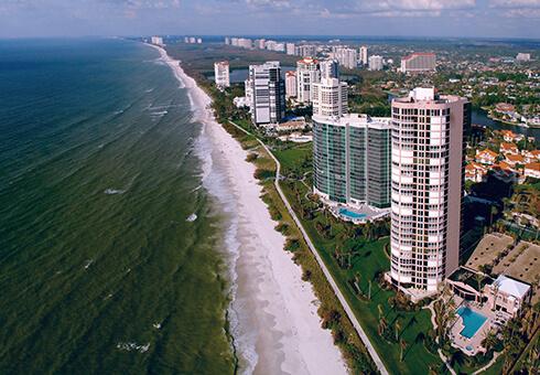 aerial view of condos along beach in naples florida